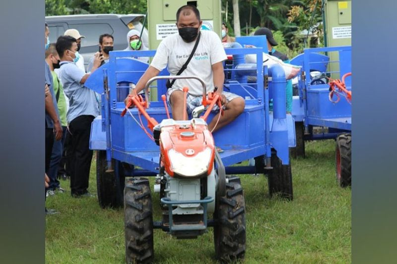 ZAMBOANGA. The national government releases 30 units of mobile rice mill equipment worth P30 million to provide livelihood to decommissioned Moro Islamic Liberation Front (MILF) combatants Thursday, June 10, 2021 at Camp Darapanan in Sultan Kudarat, Maguindanao. A photo handout shows one of the recipients drives one of the 30 units of mobile rice mill equipment. (SunStar Zamboanga)
