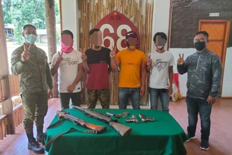 ZAMBOANGA. Four Abu Sayyaf bandits surrender Wednesday, June 9, to the Army's 68th Infantry Battalion (IB) in Lamitan City, Basilan province. A photo handout shows the four surrenderers together in a group picture with Lieutenant Colonel Napoleon Pabon, Jr., 68th Infantry Battalion commander (left) and Tuburan mayor Durie Kalahal (right) at the headquarters of the 68IB. (SunStar Zamboanga)