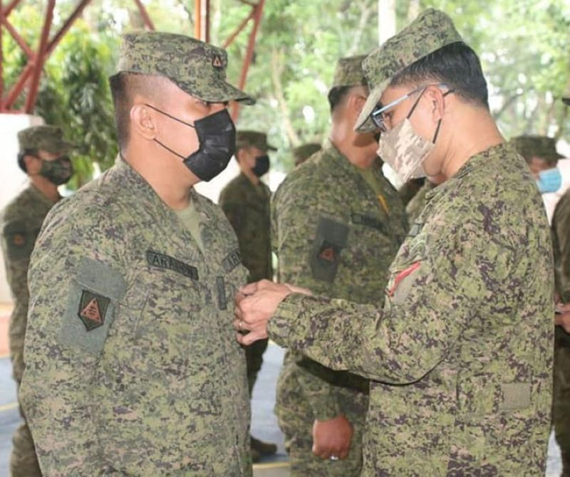 ZAMBOANGA. The Army's 53rd Infantry Battalion (IB) bestows Military Merit Medal to two officers and 13 enlisted men of the battalion for meritorious achievements in duty. A photo handout shows Lieutenant Colonel Jo-ar Herrera, 53IB commander (right), leads the awarding of medal during flag raising ceremony Saturday, June 12, held in commemoration of the country's 123rd Independence Day. (SunStar Zamboanga)
