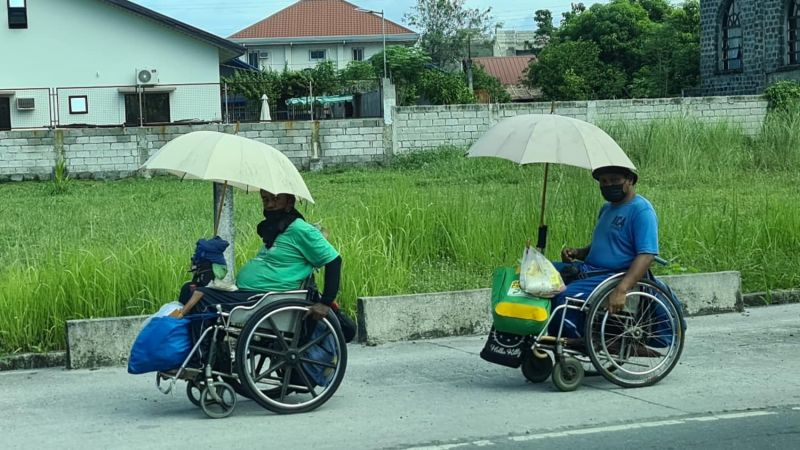 PAMPANGA. Despite their inability to walk but powered by will and determination, two persons with disabilities (PWDs) from Bacolor, Pampanga manage to get around by using their wheelchairs. The local government unit of Bacolor is giving free wheelchairs to PWDs and senior citizens. (Chris Navarro)