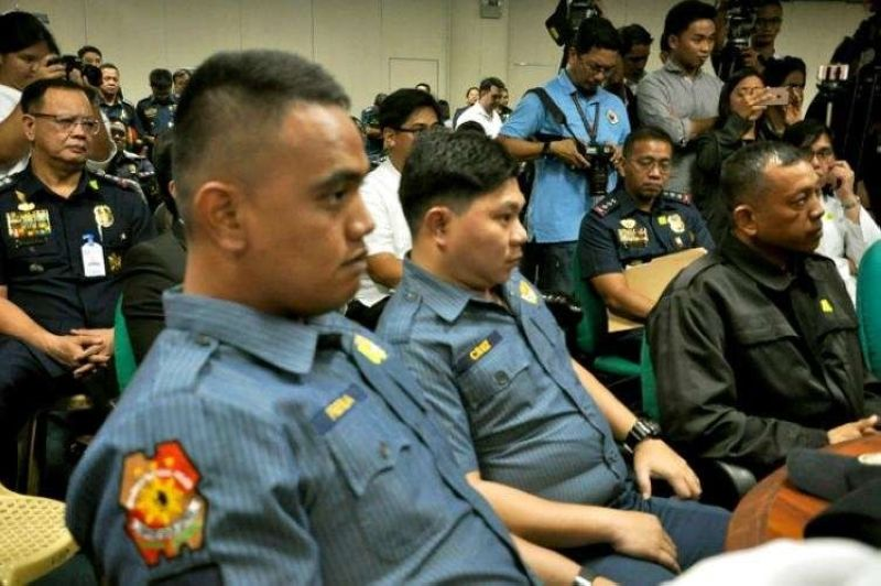 MANILA. In this file photo, former policemen Arnel Oares, Jeremias Pereda and Jerwin Cruz attend a congressional investigation into the killing of Kian delos Santos during an anti-illegal drug operation that drew public outrage. The boy was down on his knees, pleading for his life, when he was shot dead. (File)