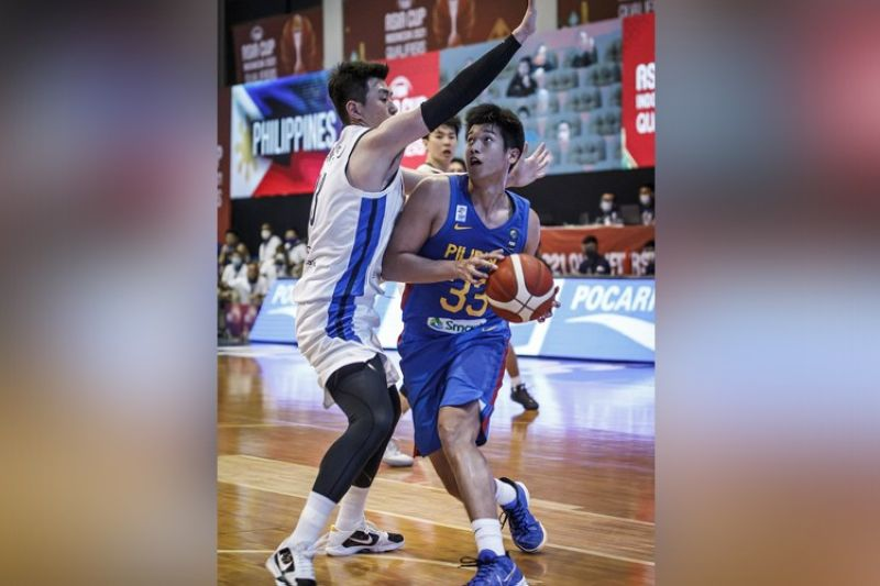 Cebuano forward Carl Tamayo showed incredible composure beyond his years as she scored 10 points in 10 minutes against Korea on Wednesday. (FIBA)