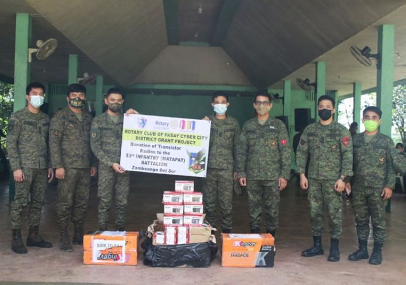ZAMBOANGA. The Rotary Club of Pasay Cyber City donates 60 units of transistor radios with batteries providing a boost to the information drive of the 53rd Infantry Battalion in its area of operations. A photo handout shows Lieutenant Colonel Jo-ar Herrera, 53IB commander (3rd from right), in a photo session together with the officers of the unit and the transistor radios they receive. (SunStar Zamboanga)