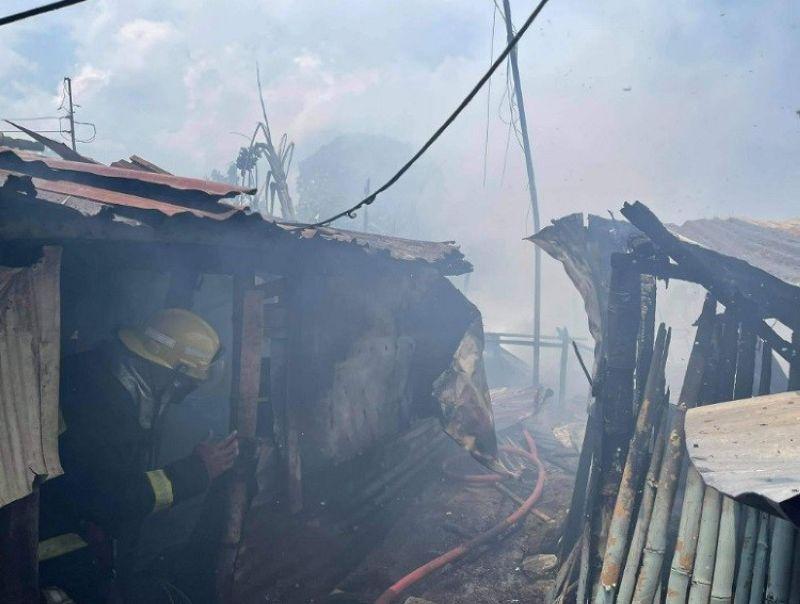 BACOLOD. Fire razes 10 houses in Barangay Bata, Bacolod City yesterday morning. (Arthur Yap photo)