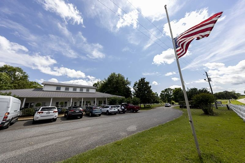 The Us Flag flies at half mast Sunday, June 20, 2021, in Camp Hill, Ala.,  at the Alabama Sheriff's Girls Ranch which suffered a loss of life when their van was involved in a multiple vehicle accident Saturday, resulting in eight people in the van perishing. (AP Photo/Vasha Hunt)