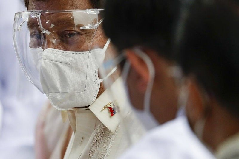MANILA. President Rodrigo Duterte wears a face mask and a face shield as protection against coronavirus disease 2019 in this photo taken on June 12, 2021. (File)