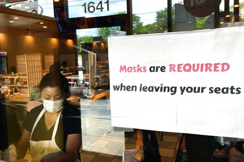 FILE - In this  June 17, 2021, file photo, a sign is displayed at a restaurant in Rolling Meadows, Ill. COVID-19 deaths in the U.S. have dipped below 300 a day for the first time since the early days of the disaster in March 2020, while the number of Americans fully vaccinated has reached about 150 million.  (AP Photo/Nam Y. Huh, File)