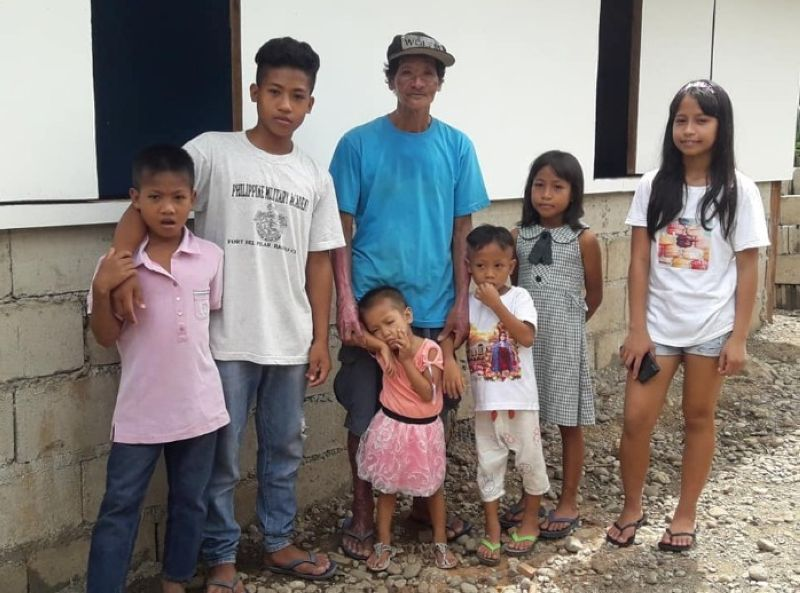 NEGROS. Victorino Beronio's family who lost their house in a fire on May 26 get their new house courtesy of the local government unit of Mabinay and the Philippine Army's 11IB. (Photo from Philippine Army)