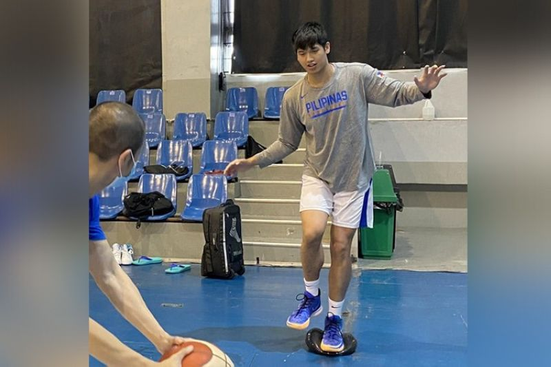 Cebuano forward Carl Tamayo is recovering well from the ankle sprain that he suffered and is seen here working with the Gilas' trainer, Dexter Aseron.(SBP)