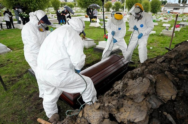 COLOMBIA. Cemetery and funeral workers lift a coffin containing the remains of a man who died of Covid-19, at the Zipaquira's Park Cemetery in Zipaquira, Colombia, Friday, June 18, 2021. (AP)