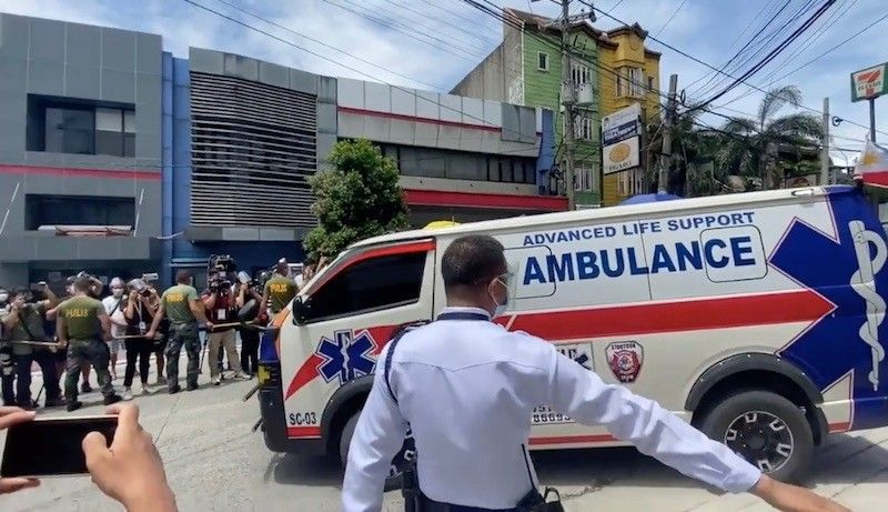 MANILA. An ambulance with a Philippine flag leaves the Capitol Medical Center before 1 p.m. Thursday, June 24, 2021. It was believed to be carrying the remains of former President Benigno S.C. Aquino III. (Third Anne Peralta-Malonzo)