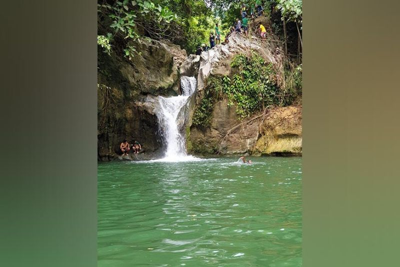 AQUATIC MANNA. Officials of the Metropolitan Cebu Water District board, led by Jose Daluz III, inspect Mangasang Falls in the mountain barangay of Tagbao, Cebu City on Thursday, June 24, 2021, eyeing it as a source of water supply for their clients. / PHILIP CEROJANO