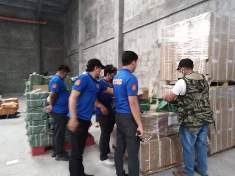 PAMPANGA. CIDG agents inspect boxes of suspected counterfeit cigarettes and raw materials discovered in Mabalacat City and San Simon town on June 24, 2021. (PRO-Central Luzon)