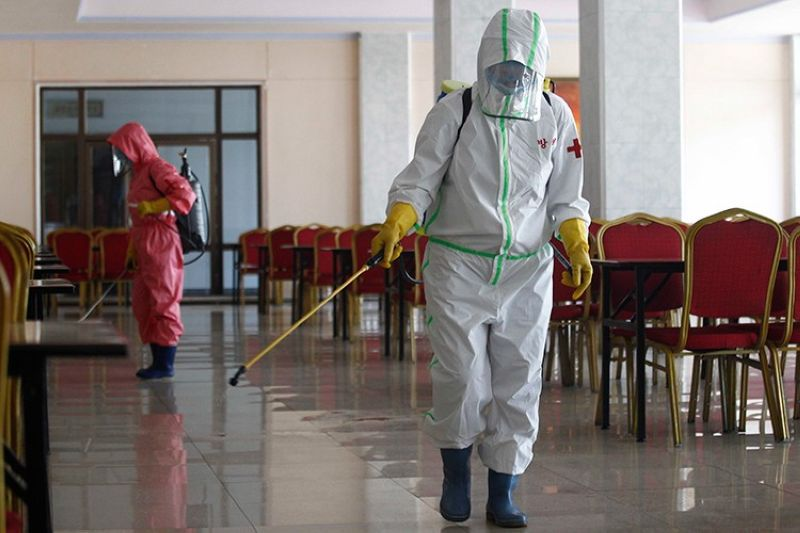 NORTH KOREA. In this May 13, 2021 file photo, restaurant staff, in protective suit, disinfect the floor of Chongchun Restaurant in Pyongyang. (AP)