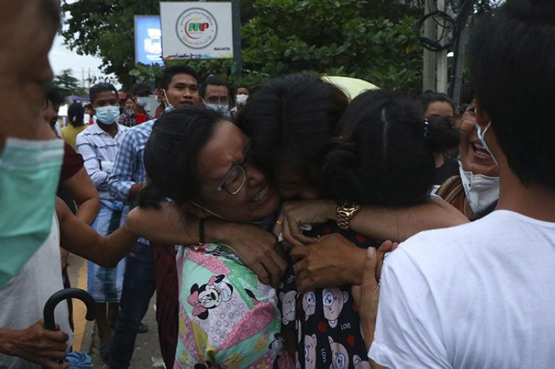 A man is hugged by two women after being released from Insein Prison in Yangon, Myanmar, Wednesday, June 30, 2021.  Myanmar's government began releasing about 2,300 prisoners on Wednesday, including activists who were detained for protesting against the military's seizure of power in February and journalists who reported on the protests, officials said. (AP Photo)