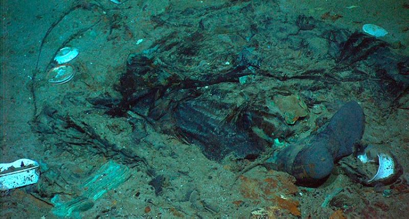 USA. This 2004 photo provided by the Institute for Exploration, Center for Archaeological Oceanography/University of Rhode Island/NOAA Office of Ocean Exploration shows the remains of a coat and boots in the mud on the sea bed near the Titanic's stern. (AP)