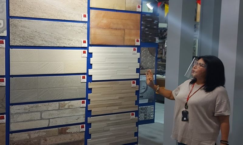 EXTENSION. Sheila Co, Cebu Home and Builders Centre showroom manager, shows off the tile products on sale at their Banilad branch. The mid-year big sale is extended until July 15, 2021. (Johanna O. Bajenting)