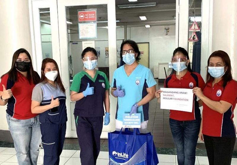 The front liners from the Research Institute for Tropical Medicine and Philippine Tuberculosis Society Inc. receive N95 masks and vitamins from the Insular Foundation.