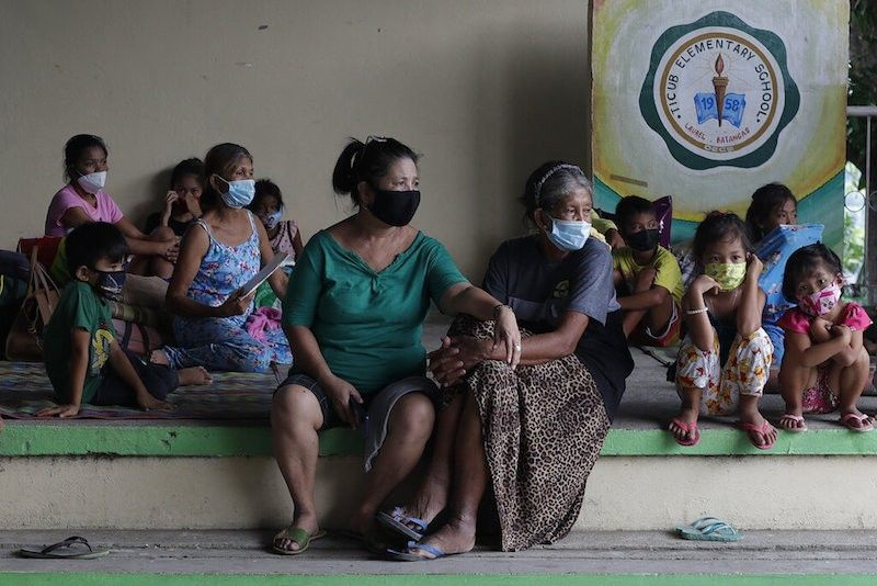 BATANGAS. Residents who fled their homes near Taal Volcano wear face masks while staying in a school turned into an evacuation center in Laurel town, Batangas on Friday July 2, 2021. (AP)