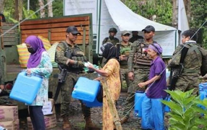 ZAMBOANGA. Major General William Gonzales, commander of the 11th Infantry Division, lauds the Community Support Team (CSP) operations team for exemplary performance while deployed in the province of Sulu. A photo handout shows the CPS operators in an outreach mission in one of the villages of Sulu. (SunStar Zamboanga)