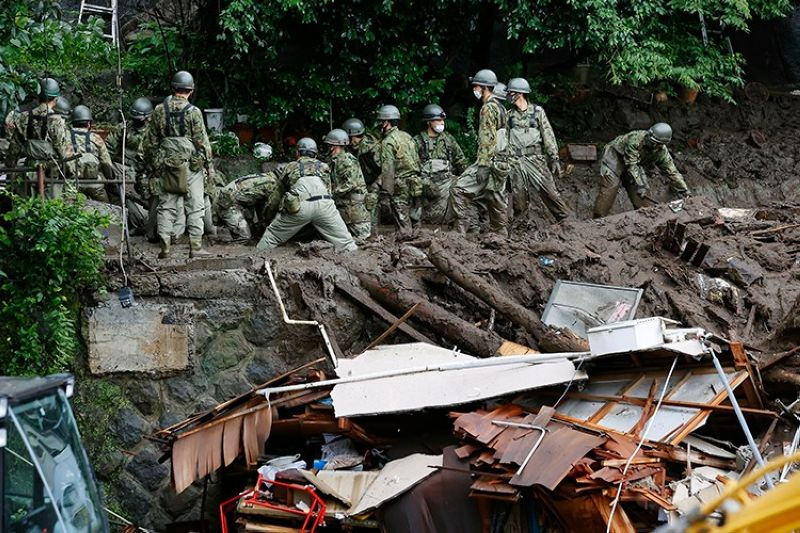 JAPAN. Rescuers continue a search operation at the site of a mudslide at Izusan in Atami, Shizuoka prefecture, southwest of Tokyo Monday, July 5, 2021. (Kyodo News via AP)