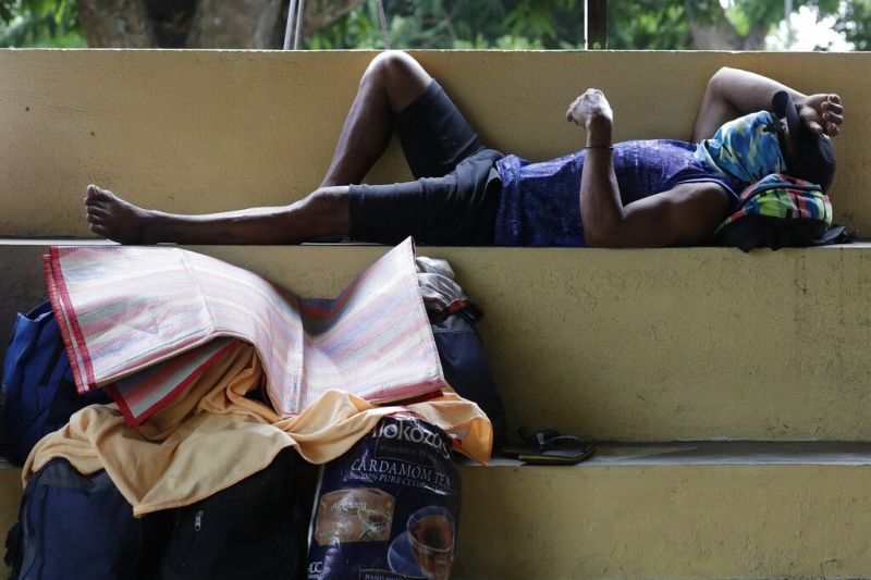 BATANGAS. A man rests at a school turned into an evacuation center in the town of Laurel, Batangas on July 2, 2021. Thousands of people were being evacuated from villages around a rumbling Taal Volcano. (AP)