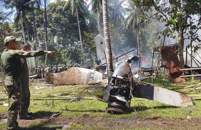 SULU. In this photo released by the Joint Task Force - Sulu, parts of a Lockheed C-130 Hercules plane are seen at the crash site in Patikul town, Sulu. (JTF Sulu via AP)