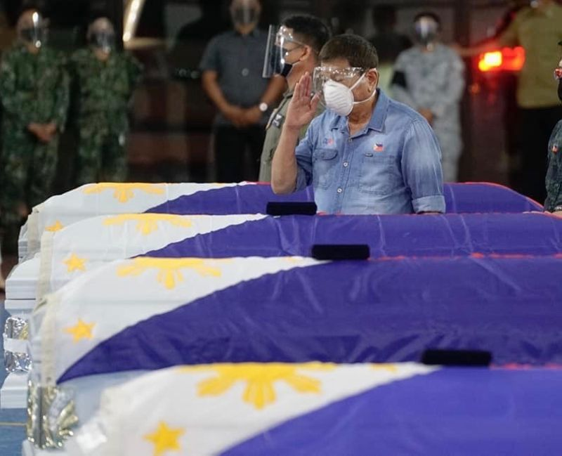 ZAMBOANGA. President Rodrigo Duterte salutes as he pays his last respects on July 5, 2021 to the soldiers who died in a military plane crash in Sulu. (Malacañang)