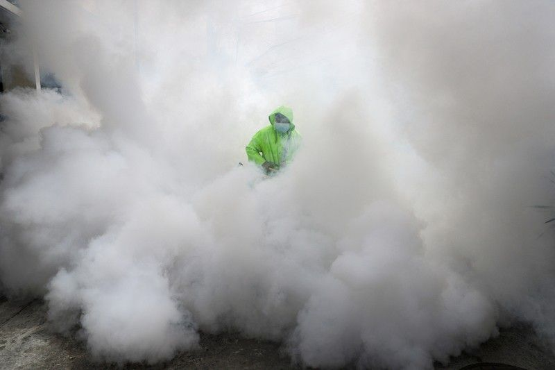 MANILA. In this photo taken in March 2021, a worker wearing a protective suit disinfects a village as a precaution against the spread of the coronavirus in Manila. (File)