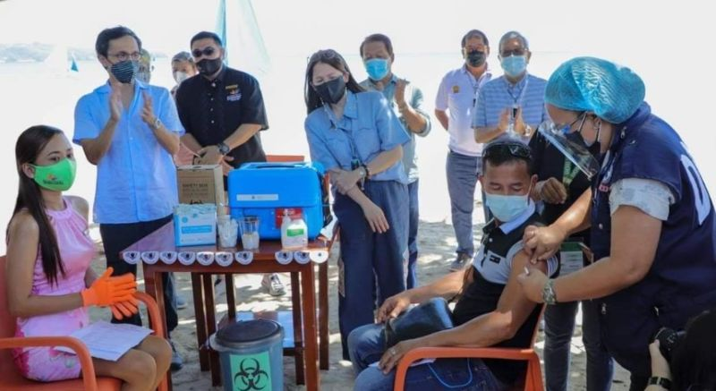 AKLAN. Tourism Secretary Bernadette Romulo-Puyat and National Task Force Against Covid-19 deputy chief implementer and testing czar Vince Dizon lead the ceremonial vaccination in Boracay Island on Wednesday, July 7, 2021. (Contributed Photo)