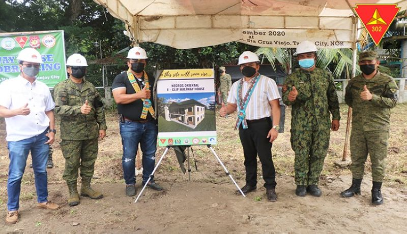 SHELTER FOR FRs. The provincial government of Negros Oriental, with other government agencies under the Enhanced Comprehensive Livelihood Integration Program, is building a halfway house for former rebels of the New People's Army. On Monday (July 5, 2021) Gov. Roel Degamo (left side of the poster) and DILG 7 Regional Director Leocadio Trovela (right) led the groundbreaking and dedication ceremony at Camp Leon Kilat in Tanjay City, Negros Oriental.  (Photo courtesy of the Philippine Army / PNA)