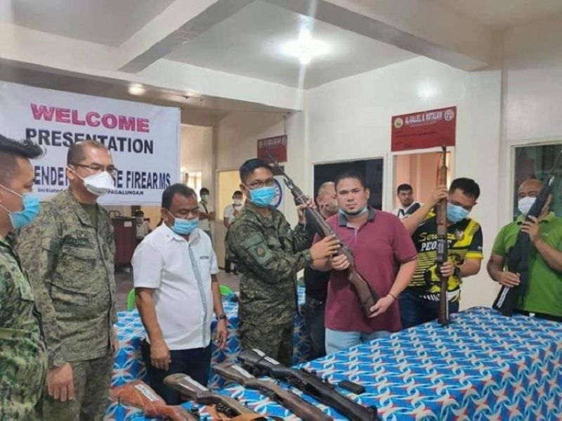 ZAMBOANGA. Six members of the Bangsamoro Islamic Freedom Fighters (BIFF) peacefully surrender Wednesday, July, 7, 2021, to government authorities in Pagalungan, North Cotabato province. A photo handout shows military and municipal officials inspecting the firearms the BIFF surrenderers yielded. (SunStar Zamboanga)