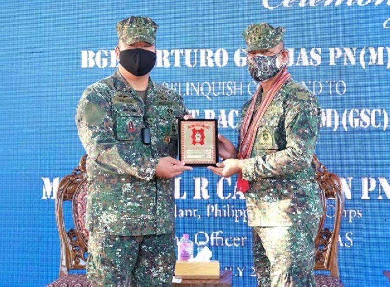 ZAMBOANGA. Brigadier General Arturo Rojas (left), relinquishes Saturday, July 10, his post as the commander of the 2nd Marine Brigade to Colonel Romeo Racadio (not in photo) in a change of command ceremony with Major General Ariel Caculitan, Philippine Marine Corps (PMC) commandant (right), as the presiding officer. A photo handout shows Caculitan receives a memento from Rojas during the ceremony. (SunStar Zamboanga)