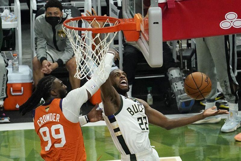 Milwaukee Bucks forward Khris Middleton (22) drives around Phoenix Suns forward Jae Crowder (99) during the second half of Game 4 of basketball's NBA Finals in Milwaukee, Wednesday, July 14, 2021. (AP Photo/Paul Sancya)