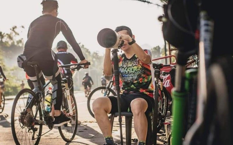 Kieron Tan in his action photos. He captures different images of bikers mostly every morning in Barangay Granada. (Photo by Dodong Photography)