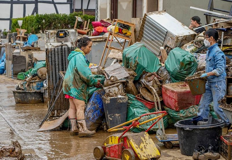 GERMANY. People clean their homes from mud and debris in Bad Neuenahr-Ahrweiler, Germany, Saturday, July 17, 2021. Due to strong rainfall, the Ahr river went over its banks and flooded big parts of the town. (AP)