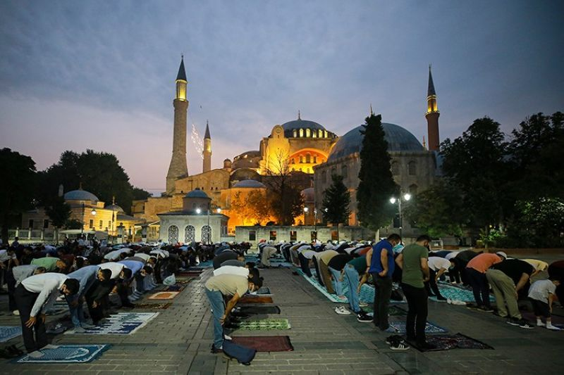 TURKEY. Muslims offer prayers during the first day of Eid al-Adha outside the iconic Haghia Sophia in the historic Sultan Ahmed district of Istanbul, Tuesday, July 20, 2021. (AP)