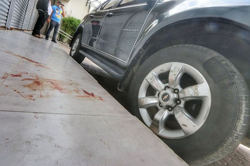 SCENE OF THE CRIME. DyRB radio blocktimer Rey Cortes was shot Thursday morning, July 22, 2021, outside his Chevrolet parked outside the radio station near the flyover in Barangay Mambaling, Cebu City. (Photo by Amper Campaña)
