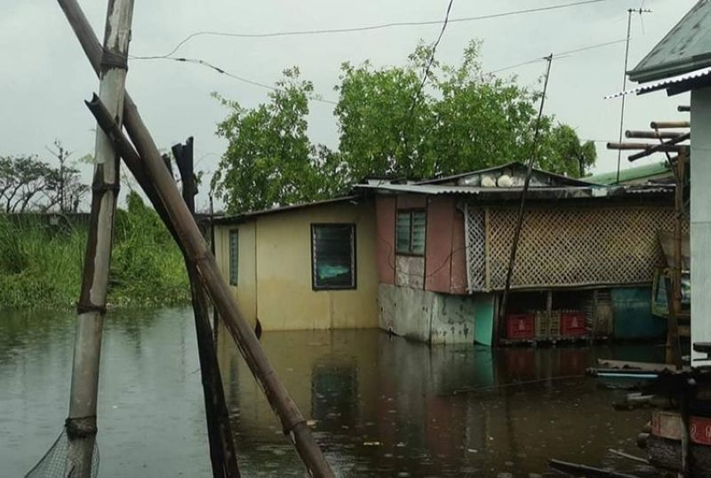 PAMPANGA. Several villages in Macabebe town remain flooded as monsoon rains brought about by Typhoon Fabian and southwest monsoon continue. (Contributed photo)