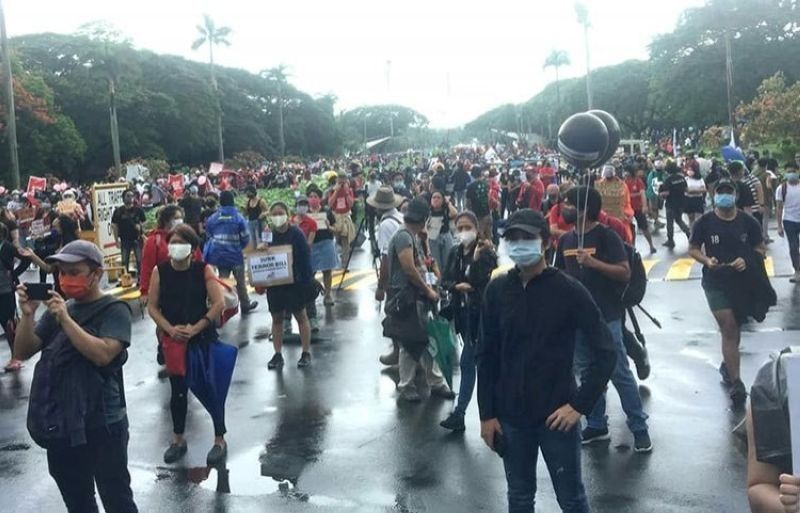 MANILA. In this photo taken in June 2020, protesters observe physical distancing and wear face masks as they converge inside the UP Diliman campus. (File)