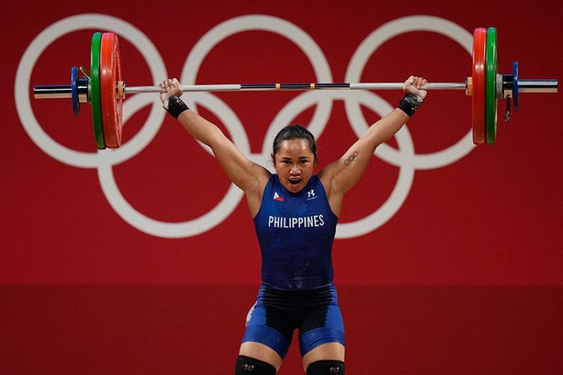 """GOLD! To borrow a line from Spandau Ballet's pop hit """"Gold,"""" there's nothing left to make the Philippines feel small. Hidilyn Diaz, 30, wins the gold in the women's 55-kilogram weightlifting division at the 2020 Summer Olympics in Tokyo, Japan on July 26, 2021, producing the first ever gold for the Philippines in the Olympics. (AP)"""