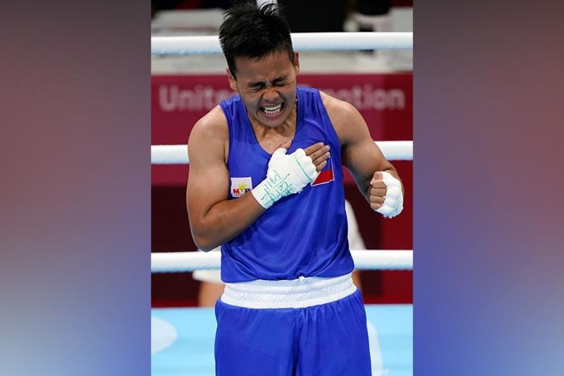 JAPAN. Nesthy Petecio reacts after winning a featherweight (57kg) preliminary boxing match against Yu-Ting Lin of Chinese Taipei, at the 2020 Summer Olympics, Monday, July 26, 2021, in Tokyo, Japan. (AP photo)