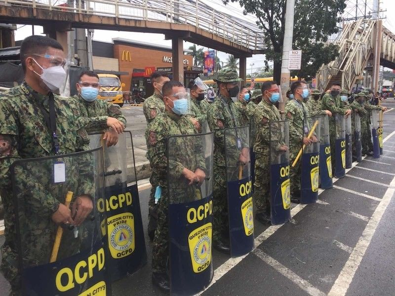 MANILA. Anti-riot policemen position themselves along Commonwealth Ave., Quezon City to maintain peace and order during the protest actions related to the State of the Nation Address on July 26, 2021. (Third Anne Peralta-Malonzo)