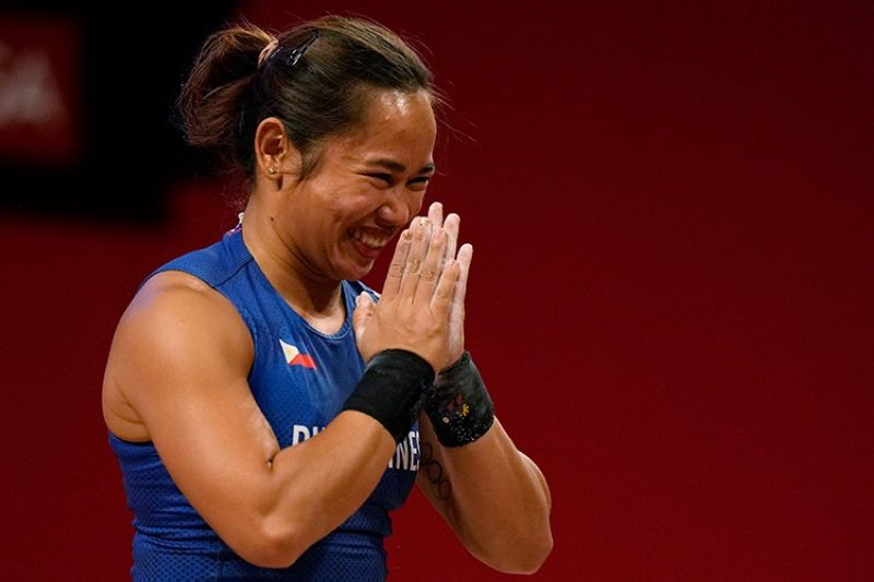JAPAN. Hidilyn Diaz of Philippines celebrates after a lift as she competes in the women's 55kg weightlifting event, at the 2020 Summer Olympics, Monday, July 26, 2021, in Tokyo, Japan. (AP)