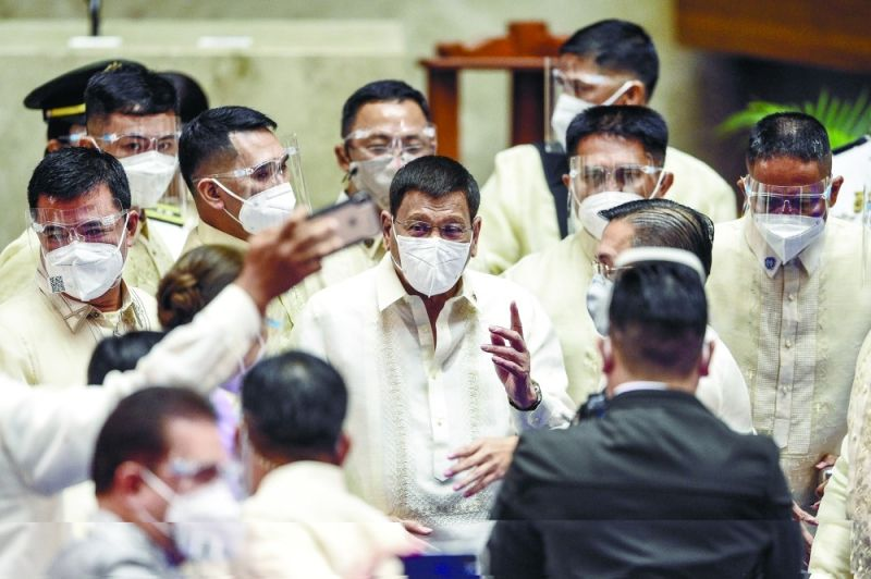 FINAL SONA. President Rodrigo Duterte is surrounded by security after he delivered his final State of the Nation Address at the House of Representatives in Quezon City on Monday, July 26, 2021. / POOL VIA AP