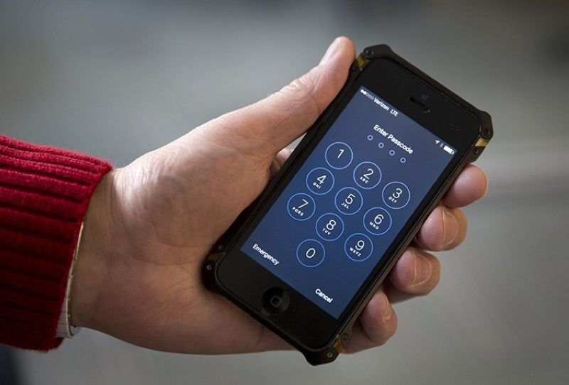 In this Feb. 17, 2016, file photo an iPhone is seen in Washington. At a time of widespread digital insecurity it turns out that the oldest and simplest computer fix there is — turning a device off then back on again — can thwart hackers from stealing information from smartphones. (AP Photo/Carolyn Kaster, File)