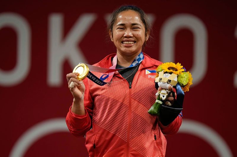 JAPAN. Hidilyn Diaz of Philippines celebrates on the podium after winning the gold medal in the women's 55kg weightlifting event, at the 2020 Summer Olympics, Monday, July 26, 2021, in Tokyo, Japan. (AP)