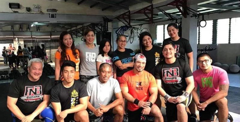 FITNESS BUFFS. Angeles Mayor Carmelo Lazatin Jr. and Olympic gold medalist Hidilyn Diaz join physical fitness buffs during a workout break at a gym in the city. (Angeles City Information Office)