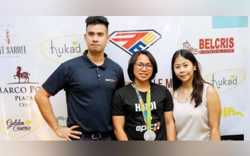 GOLDEN. Hidilyn Diaz in Cebu after the 2016 Rio Olympics, flanked by Pio Solon and Silver Mercado of Epic Performance and Fitness.