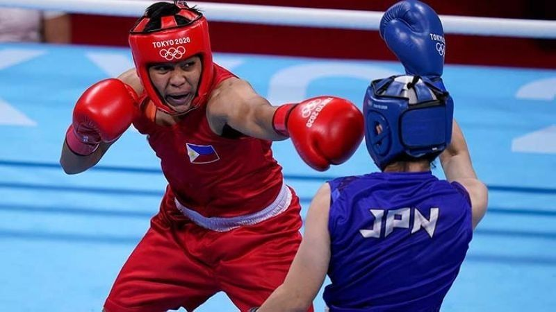 SILVER. Nesthy Petecio of the Philippines lost by unanimous decision to Sena Irie of Japan in their gold medal match on Aug. 3, 2021. / AP